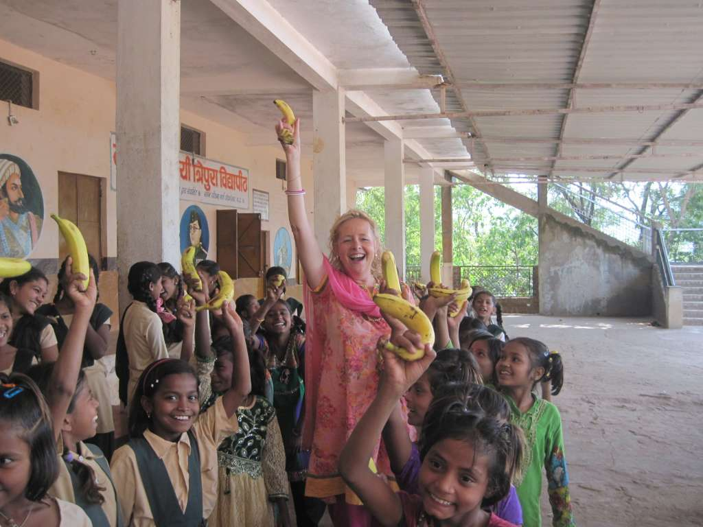 Member of Executive Board Haripriya active, handing out bananas, to all school children