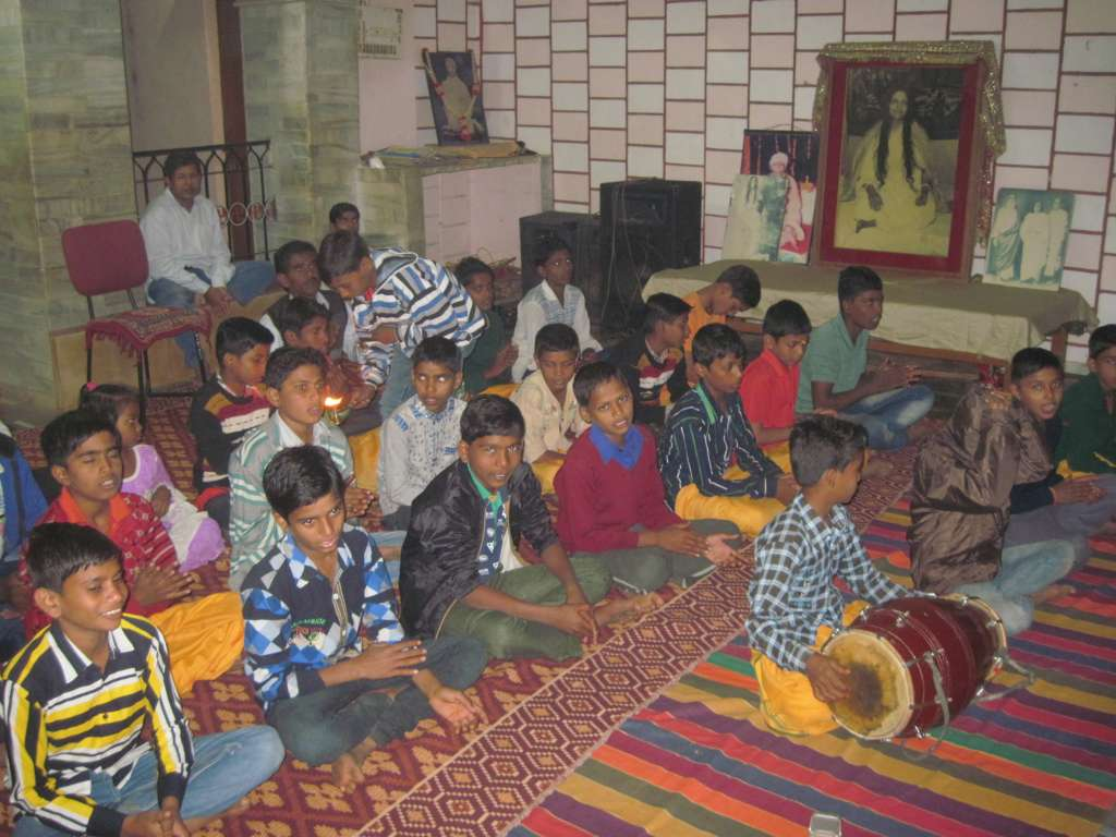 singing hostel children with the Arati in the temple